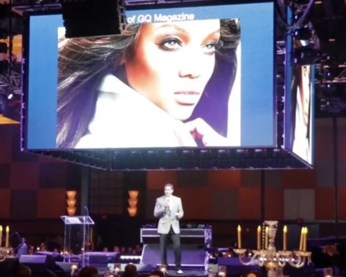 Our benefit auctioneer on stage in Houston, TX
